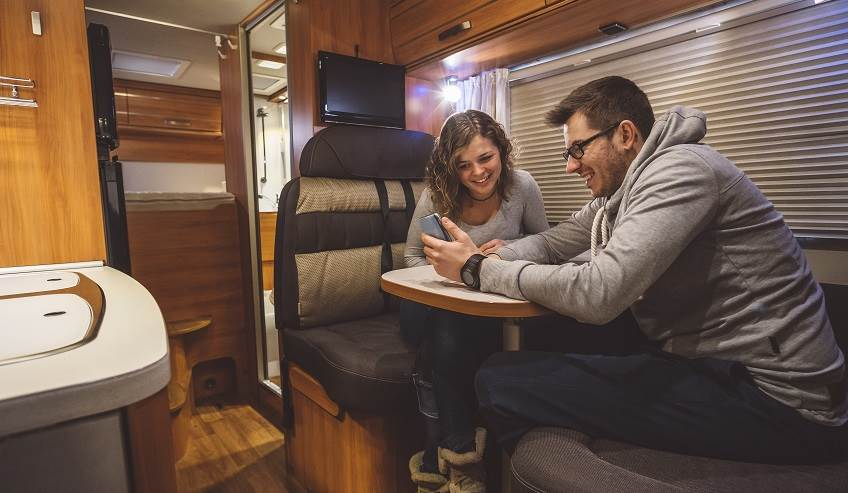 Couple sitting in an RV