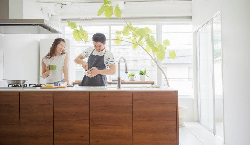 Couple making dinner on a kitchen island